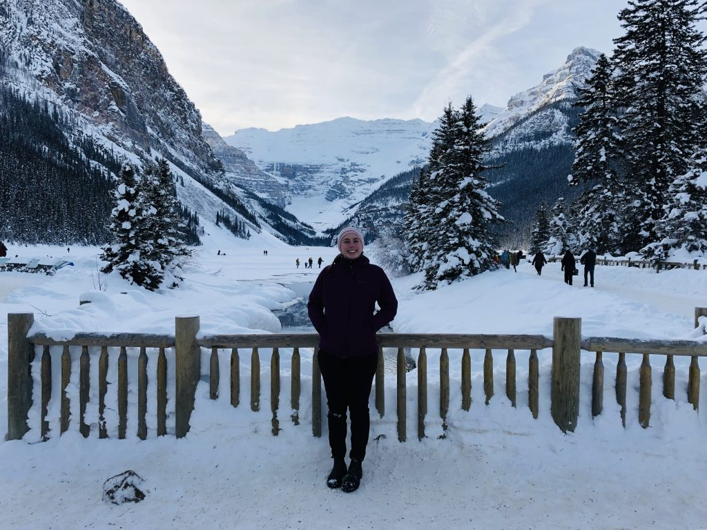 Mikaela standing near a bridge at Lake Louise, wearing Gamma LT women's hiking pants.