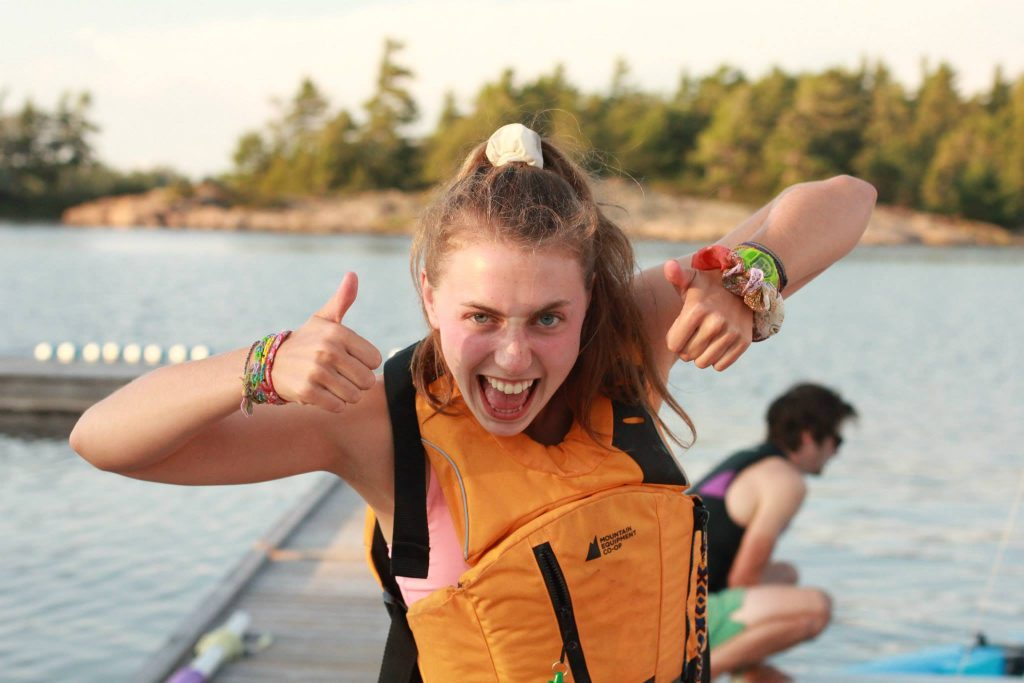 Mikaela giving two big thumbs up. She's wearing a MEC Fulcrum, one of the best budget life jackets.