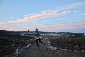 Jumping in front of Iqaluit houses
