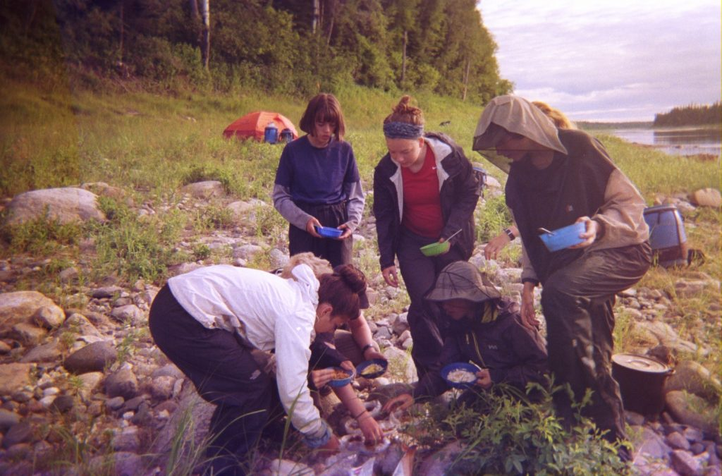 Campers making oatmeal on the side of the Missinaibi