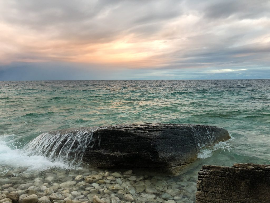 Water rushing over a rock on the coast of Georgian Bay, near High Dump camping in Bruce Peninsula National Park