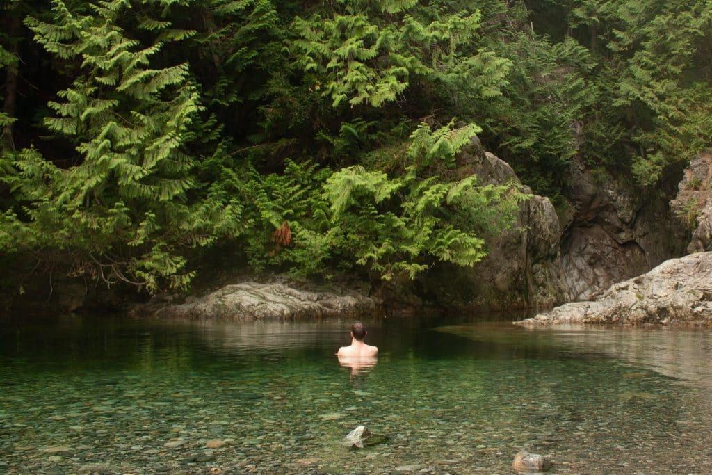 Guy swimming in water near 30 ft pool in Lynn Canyon