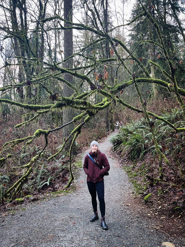 Mikaela standing on a Vancouver hike in Burnaby Mountain