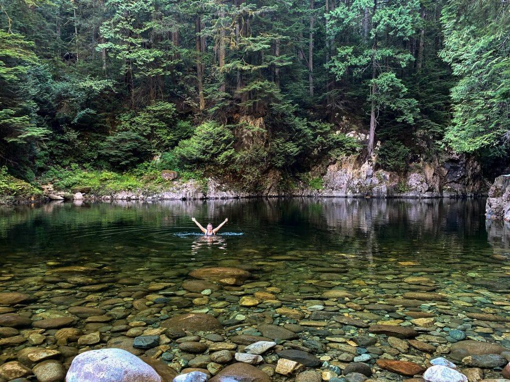 Girl swimming in Capilano River