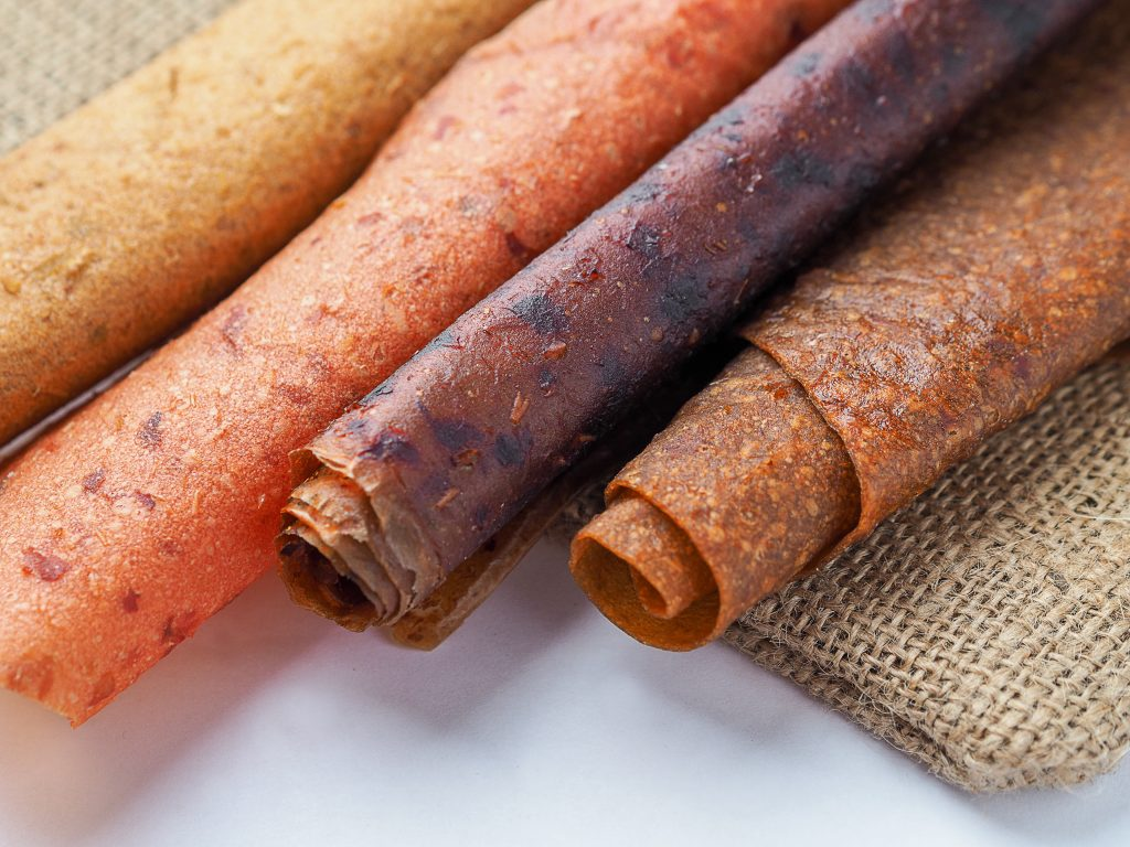 Fruit leather is a good hiking snack. You can make it at home by dehydrating apple sauce in the oven.